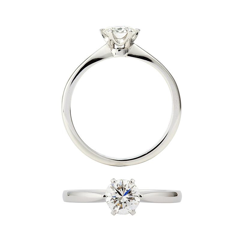 Engelbert Stockholm Ring i platina består av en spetskena med 6 klor med en  briljantslipad diamant från 0 2b08b453aa615