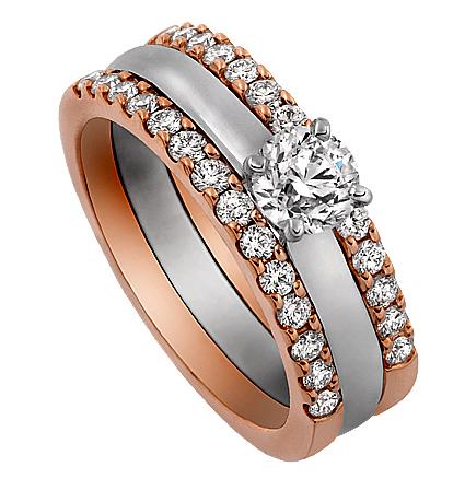 Ram ringen Victoria med 2 rader diamanter i Roseguld med Enstensring Mayfair i mitten i vitguld. Av Juvelerare David Harper.